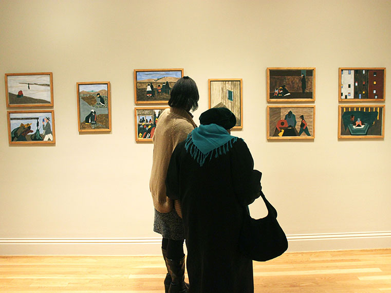 Students interview older Washingtonians in an art gallery in Washington DC.
